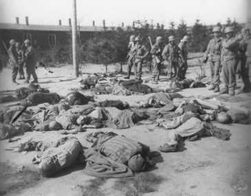 US soldiers confront the corpses of prisoners killed in Ohrdruf shortly before the camp's liberation. Ohrdruf, Germany, April 4, 1945.