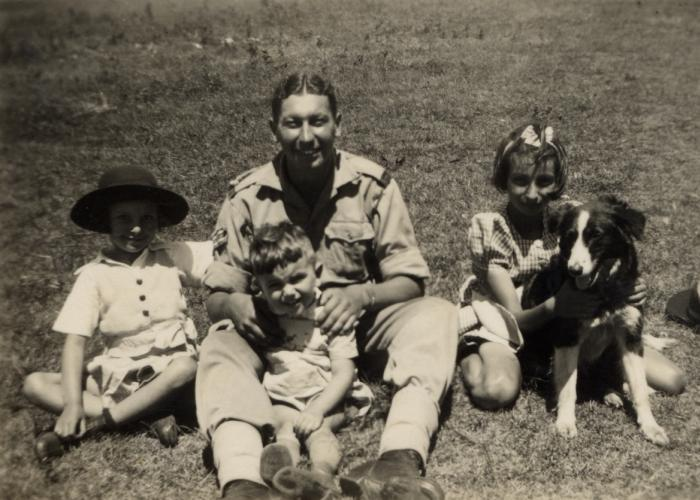 A Jewish soldier in the British army poses with refugee children from Germany on their farm in Kenya where he had come to celebrate Jewish holidays. Gisela Berg is on the far left and her sister Inge is on the right.