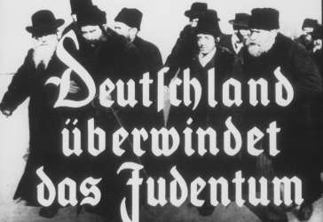 "Propaganda slide entitled ""Germany overcomes Jewry."""
