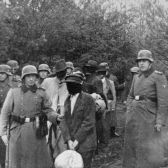 SS personnel lead blindfolded Polish prisoners to an execution site near Warsaw.