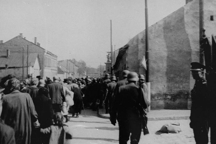 A column of Jews forced to march through the streets of Krakow during the final liquidation of the ghetto. Krakow, Poland, 1943.