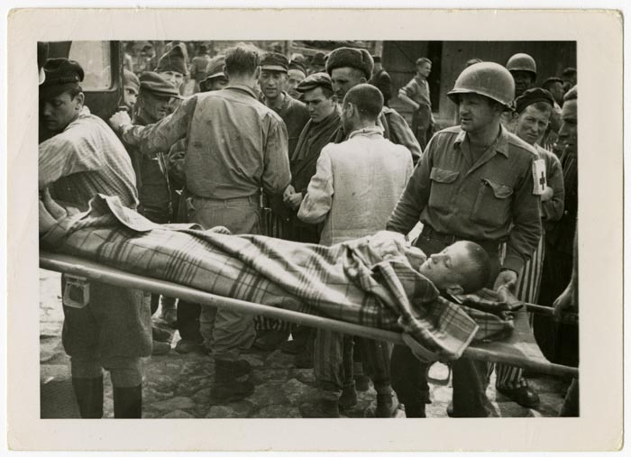 US Army medics help evacuate ill and starving survivors. Buchenwald, Germany, April 1, 1945.