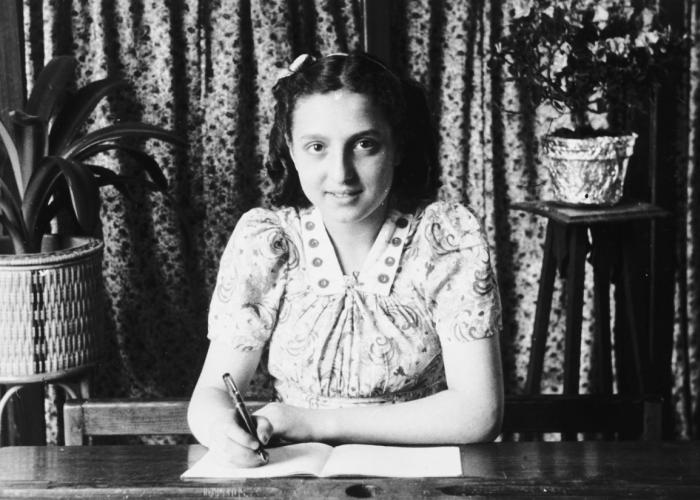 Flora Mendelowicz writes in her notebook while studying at a Catholic school in Brussels soon after the liberation.
