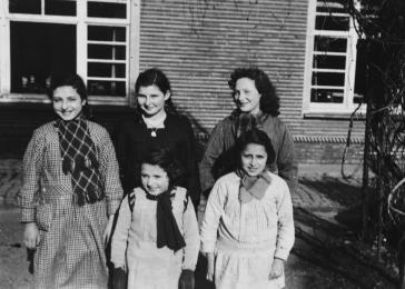 "Group portrait of Jewish girls Betty, Charlotte, and Flora Mendelowicz and Ruth Wallach and Paulette (last name unknown) living in hiding at the ""Our Lady of Seven Sorrows"" convent in Ruiselede, Belgium."