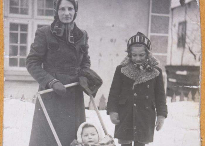 Olga Litman walks down a snowy street with her two daughters, Halina and Eva.