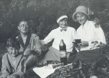 Fritz Glueckstein (left) on a picnic with his family in Berlin in 1932. Fritz's father was Jewish and attended services in a liberal synagogue. His mother was Christian. Under the Nuremberg Laws of 1935, Fritz would be classified as mixed-raced (<i>Mischling</i>), but since his father was a member of the Jewish religious community, Fritz was classified as a Jew.