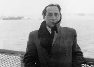 Miles Lerman stands on the deck of the SS <i>Marine Perch</i> upon its arrival in New York harbor. February 11, 1947. <i>US Holocaust Memorial Museum</i>