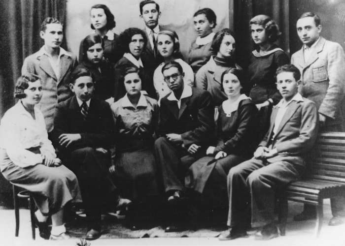 Members of the Hashomer Hatzair Zionist youth movement gather for a portrait. Miles Lerman is in the front row, second from left. Lvov, Poland, 1937. <i>US Holocaust Memorial Museum</i>