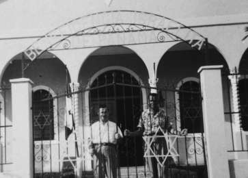David Bajer, a Jewish DP immigrant from Poland, stands at the gate to a synagogue in Panama City.
