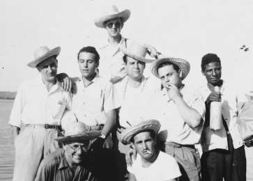 Group portrait of the crew of a Jewish Agency arms ship in Antilla Harbor. David Bayer stands of the left.