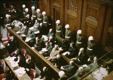 View of the defendants in the dock at the International Military Tribunal trial of war criminals at Nuremberg. November 1945.