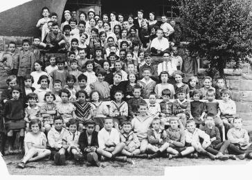 Group of German Jewish children in a summer camp in Bad Sassendorf. Gerd Zwienicki is in the center, front row.