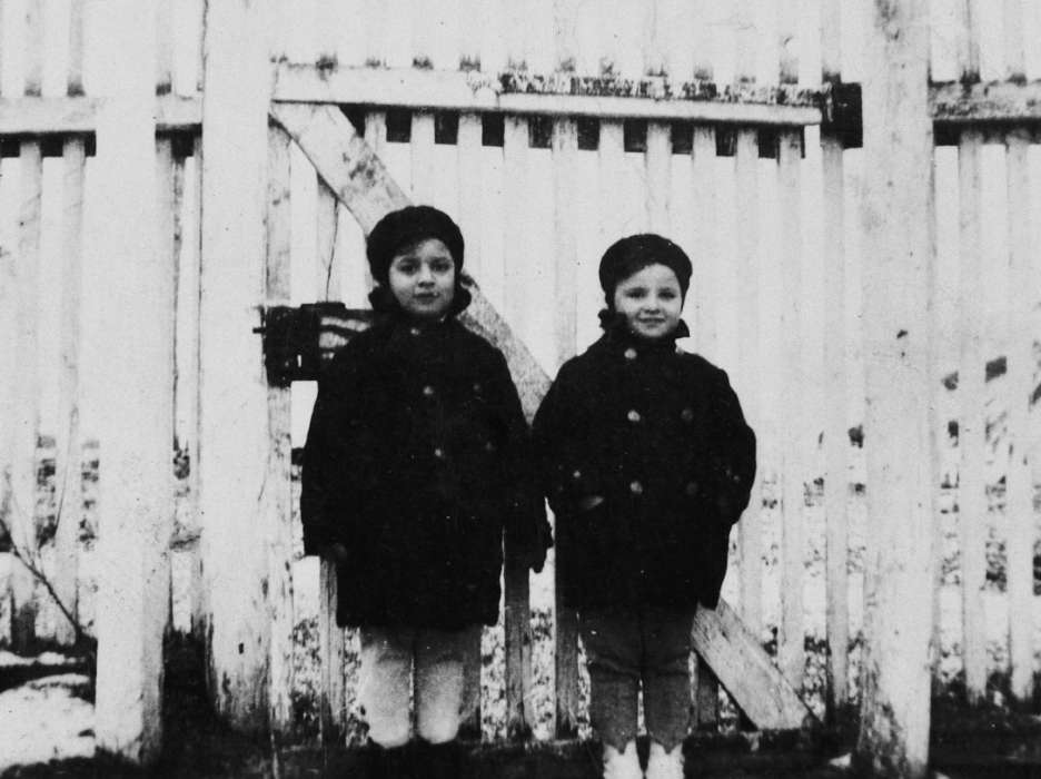 Agnes and Zsuzi Laszlo stand together next to a wooden fence in Pogony Puszta.