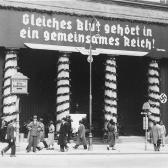 "The Loos Haus, Vienna, 1938. The banner reads, ""Those of the same blood belong in the same Reich!"" (April 1938)"