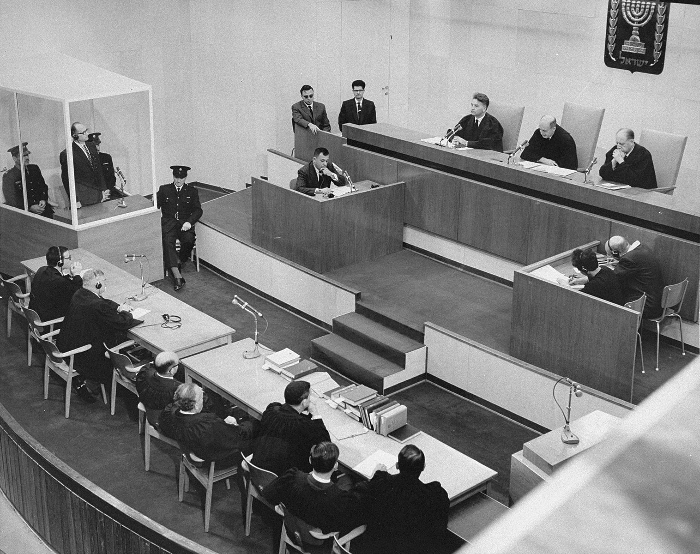Adolf Eichmann listens as he is sentenced to death by the court.