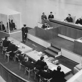 Eichmann listens as he is sentenced to death by the court.
