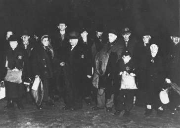 German Jews from the town of Coesfeld are assembled for deportation to Riga, Latvia. Coesfeld, Germany, December 10, 1941.