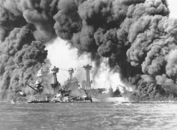 Smoke billows from US ships hit during the Japanese air attack on Pearl Harbor.