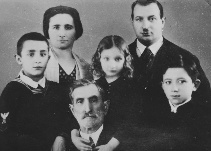 Studio portrait of Yechezkel, Sara, Nesse and Menashe Galperin.