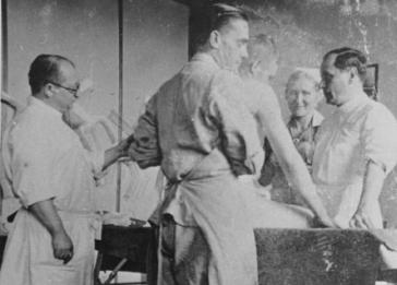 Nazi physician Carl Clauberg (at left), who performed medical experiments on prisoners in Block 10 of the Auschwitz camp. Poland, between 1941 and 1944.