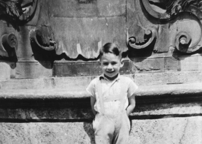 Kurt Pauly posed in front of a large fountain in Wuerzberg.