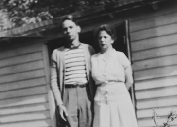 German-Jewish immigrants, Selma Herz Pauly and her son, Kurt, pose outside their home on a chicken farm in Vineland, NJ.