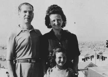 Jacques, Fajga, and Josiane Aizenberg (in front) poses on the terrace of a building after being reunited after the war, circa 1946.