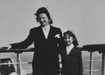 Fajga and Josiane Aizenberg pose on the top deck of a ship while on route to the United States.
