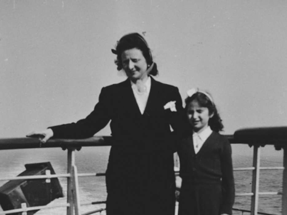 Fajga and Josiane Aizenberg pose on the top deck of a ship while on route to the United States, circa 1949.