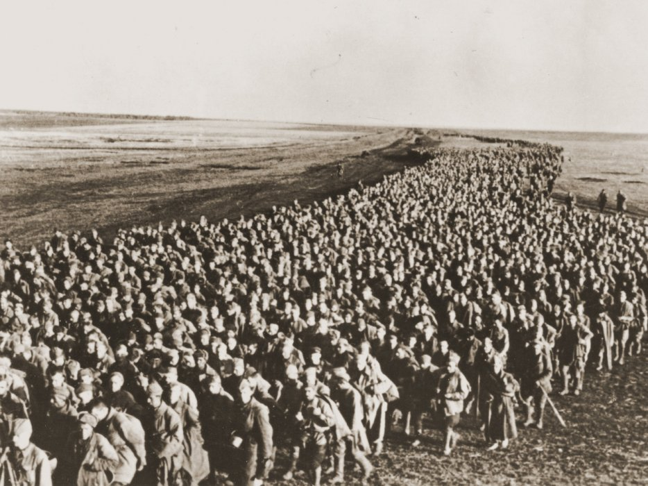 A huge column of Soviet prisoners from the Kharkov front, struggling across a plain. The Germans shot many prisoners who fell along the way.