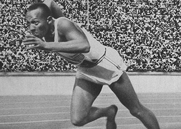 American Olympic athlete Jesse Owens runs his historic 200 meter race at the 11th Olympiad in Berlin. Owens won the race with a time of 20.7 seconds, establishing a new Olympic record.