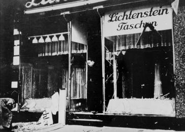 A man surveys the damage to the Lichtenstein leather goods store after the Kristallnacht pogrom.