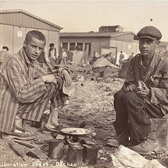 Two survivors at Dachau.