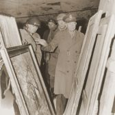 Eisenhower inspects stolen art.
