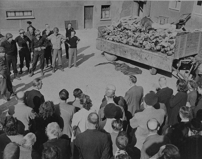 German civilians under US military escort are forced to view a wagon piled with corpses in the newly liberated Buchenwald concentration camp. Buchenwald, Germany, April 16, 1945. <i>US Holocaust Memorial Museum, courtesy of Lee Moody</i>