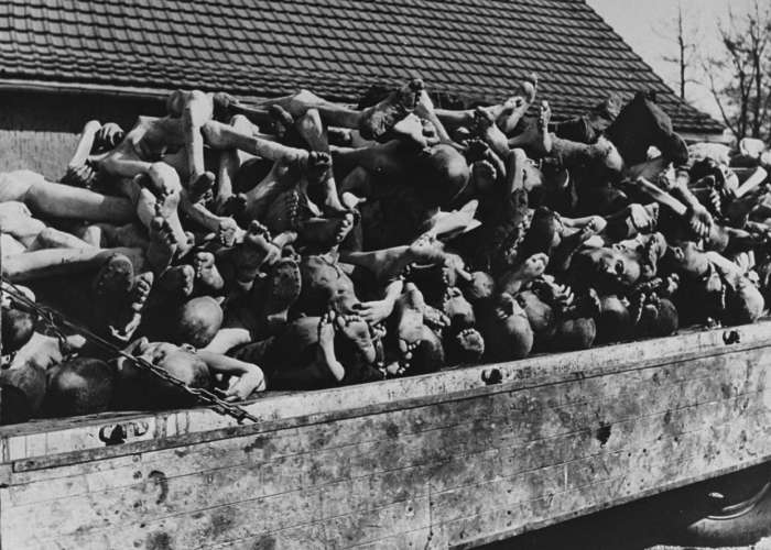 A wagon is piled high with the bodies of former prisoners in the newly liberated Buchenwald concentration camp. Buchenwald, Germany, April 11-May 1945. <i>US Holocaust Memorial Museum, courtesy of David Wittenstein</i>