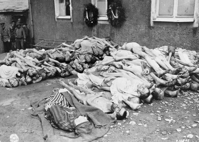 The bodies of former prisoners are stacked outside the crematorium in the newly liberated Buchenwald concentration camp. Buchenwald, Germany, April 23, 1945. <i>US Holocaust Memorial Museum, courtesy of National Archives and Records Administration, College Park, MD</i>