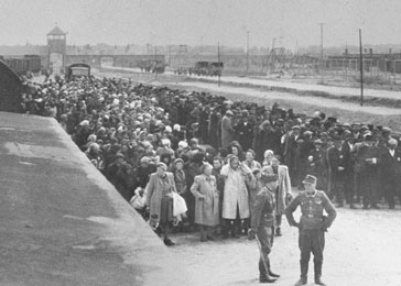 Jews lined up for selection on the ramp at Auschwitz-Birkenau. Poland, May 1, 1944.