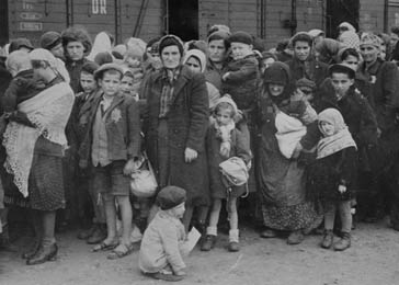 Jewish women and children from Subcarpathian Rus await selection on the ramp at Auschwitz-Birkenau. Poland, 1944.