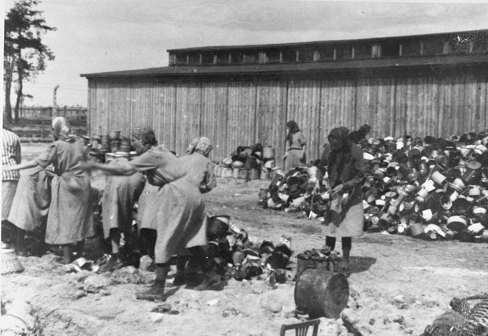 Prisoners sort clothes in Auschwitz