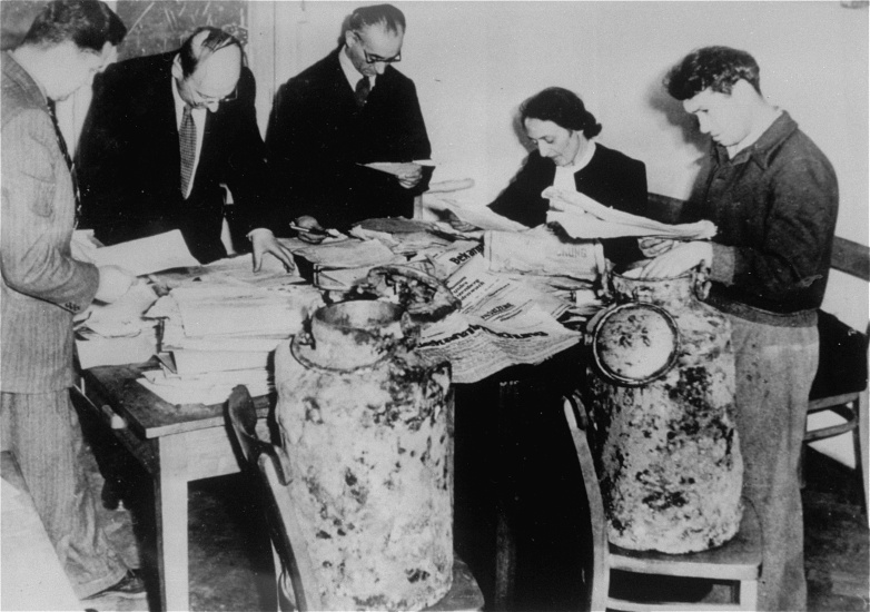 Archivists at the Jewish Historical Institute in Warsaw sort through the portion of the Oneg Shabbat archive retrieved from two milk cans discovered on December 1, 1950, in the ruins of the former ghetto. <i>US Holocaust Memorial Museum, courtesy of Yad Vashem Photo Archives</i>