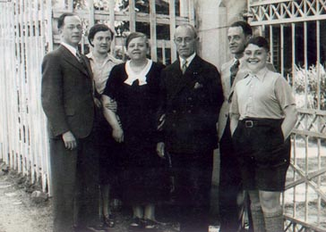 Group portrait of a German Jewish family in Bad Ems, Germany, ca. 1936. Fred Oppenheimer (at far right) rode his bicycle to and from school each day. After the Nuremberg Laws were passed in 1935, he recalls nearly daily attacks from other children on his way home from school.