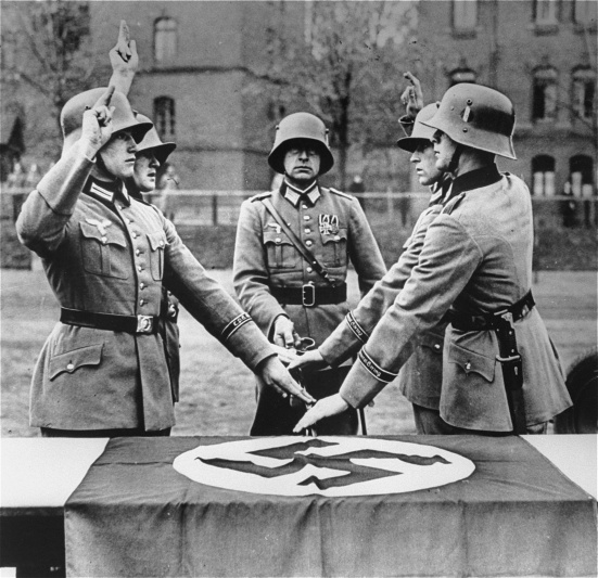 After the death of President Paul von Hindenburg in August 1934, German military recruits swore unconditional obedience to Hitler personally rather than take an oath to the Constitution. <i>Süddeutscher Verlag Bilderdienst</i>