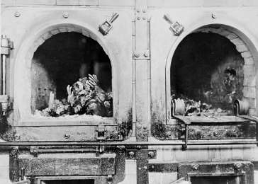 The charred remains of former prisoners in two crematoria ovens in the newly liberated Buchenwald concentration camp. Buchenwald, Germany, April 14, 1945. <i>US Holocaust Memorial Museum, courtesy of National Archives and Records Administration, College Park, MD</i>