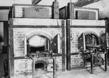 Two ovens inside the crematorium at the Dachau concentration camp. Dachau, Germany, July 1, 1945. <i>US Holocaust Memorial Museum, courtesy of National Archives and Records Administration, College Park, MD</i>