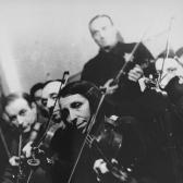 Violinists perform in the Kovno ghetto orchestra.