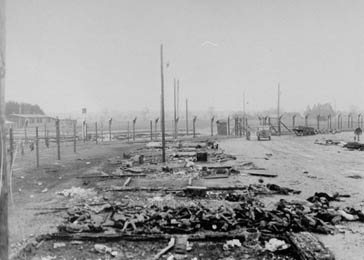 Corpses lie in a pile beside the charred ruins of barracks in the Kaufering IV concentration camp. The SS set fire to the barracks killing hundreds of prisoners who were too ill or weak to move. The camp was set on fire prior to the arrival of the US Army on April 27, 1945.