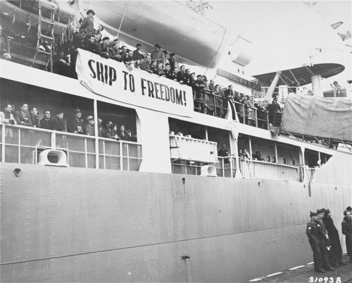 "Displaced persons (DPs) line the decks of the <i>General Black</i> as it leaves the port of Bremerhaven. Dubbed the ""Ship to Freedom"" by its passengers, it brought 813 European DPs from eleven nations to the United States under the provisions of the newly enacted Displaced Persons' Act. These were the first DPs allowed to enter the United States under the new quota. The ship's departure from Bremerhaven was marked by speeches by US military and civilian leaders and by an army band concert."