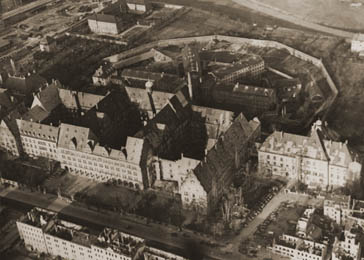 Aerial view of the Nuremberg Palace of Justice and prison, where the war crimes trial of the International Military Tribunal was held and its defendants incarcerated. November 20, 1945.