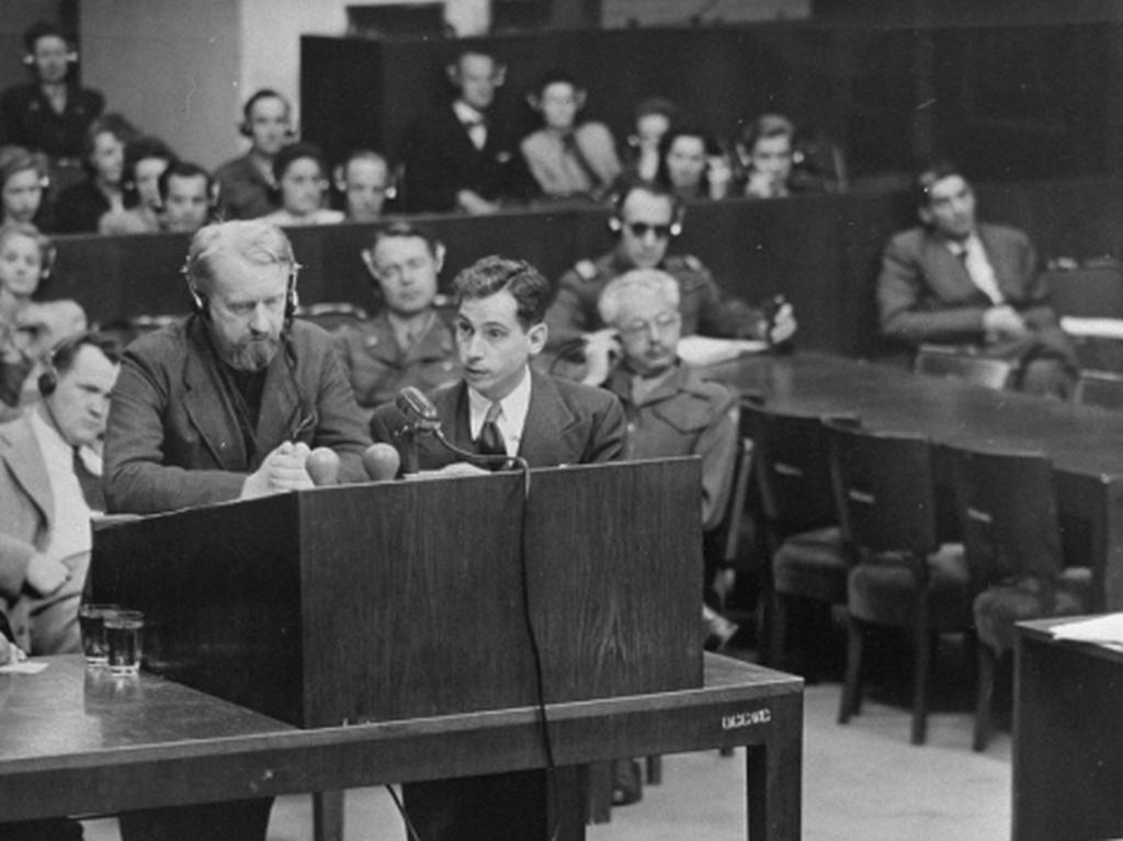 Defendant Gerhard Rose (standing, left) next to Chief Prosecutor James M. McHaney during the Doctors Trial. Nuremberg, Germany, June 16, 1947.